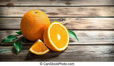 Fresh oranges with leaves.