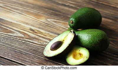 Fresh organic avocado on dark old wooden table
