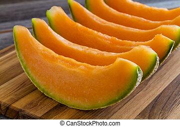 Fresh organic cantaloupe melon - Cantaloupe melon slices...