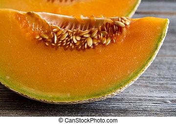 Fresh organic cantaloupe melon - Close up of two cantaloupe...