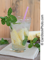 Fresh organic carissa carandas juice on wooden background with fresh fruits