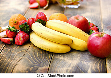 Fresh organic fruit, healthy vegetarian food on rustic table