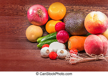 Fresh organic fruits and Vegetable on wooden table wall background with copy space .