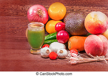 Fresh organic fruits and Vegetable on wooden table wall background withwith copy space .