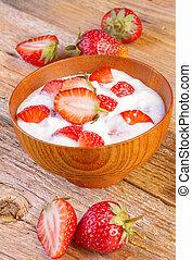 greek yogurt with strawberries on wood