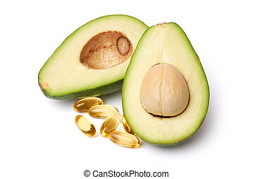 Fresh organic halved avocado and capsules with Omega-3 isolated on white background with clipping path