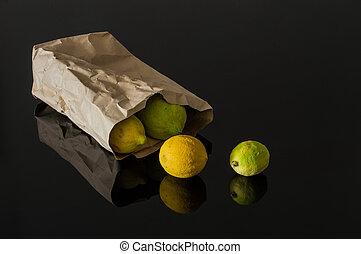 Fresh organic lemons in a paper bag