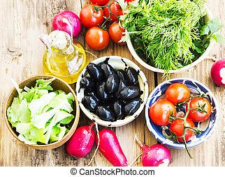 Fresh Organic Olives, Greens, Radish and Cherry Tomatoes in Bowl