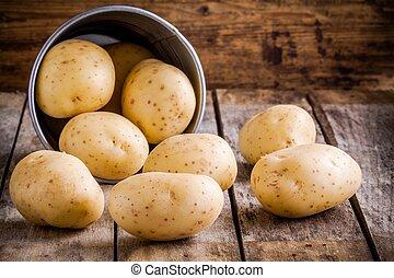Fresh organic raw potatoes in a bucket