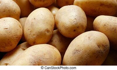 Fresh organic raw potatoes in the market