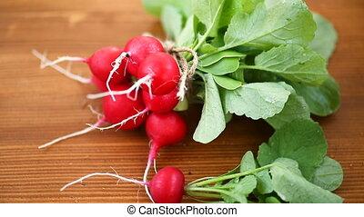 fresh organic red radish on a wooden table - fresh organic...