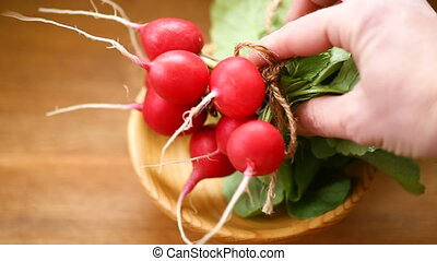 fresh organic red radish on a wooden table - fresh organic...