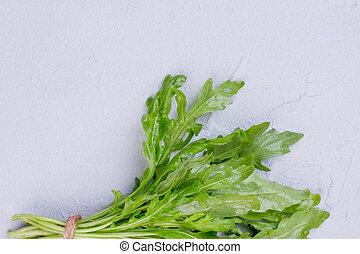 Fresh organic roquette, copy space. Twigs of arugula herb on...