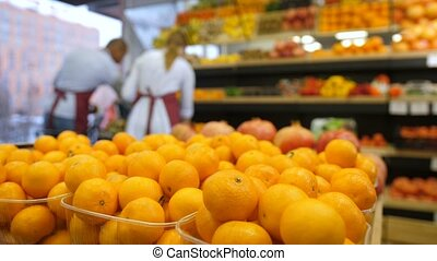Fresh organic tangerines in grocery boxes at store - Fresh...