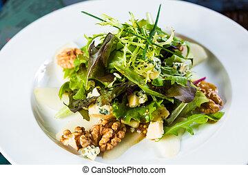 Fresh organic vegetable salad on whte plate.