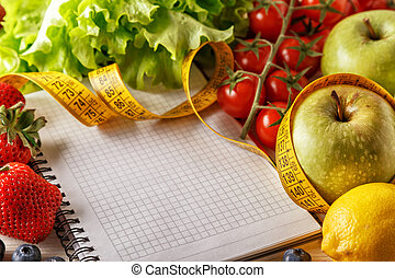 Fresh organic vegetables and fruits, open blank notebook and pen on wooden background.