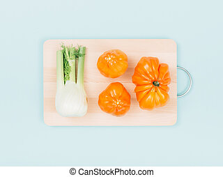 Fresh organic vegetables on a chopping board