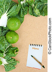 Fresh organic vegetables on a Wooden Background and paper for notes