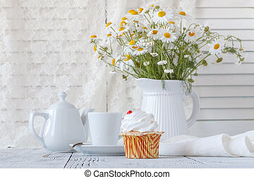 Fresh Oxeye Daisies on table in white Pitcher in interior
