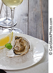 Fresh oysters and wine - Fresh oysters platter served in ice...