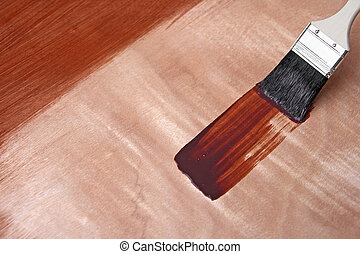 Fresh paint on wooden surface - Paintbrush and fresh paint...