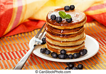 Fresh pancakes with blueberries and honey