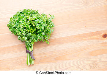 Fresh parsley on a light wooden background