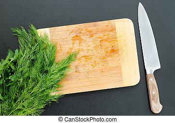 Fresh parsley on cutting board with knife