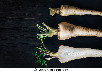 Fresh parsley root on wooden table