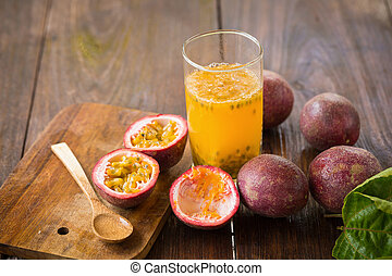 Fresh passion fruits on a wooden background.
