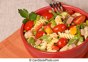 Fresh pasta salad in a red bowl