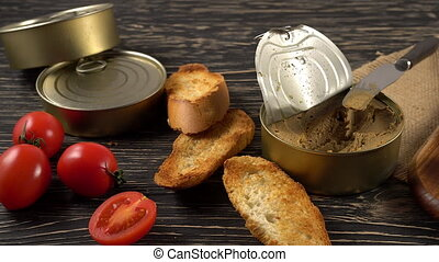 Fresh pate with bread on wooden table