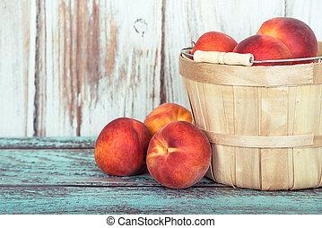 Fresh peach fruits in a basket