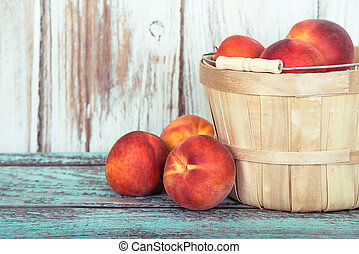 Fresh peach fruits in a basket