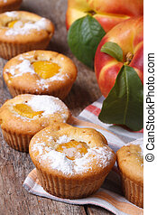 fresh peach muffins sprinkled with powdered sugar