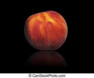 Fresh peach on a black background