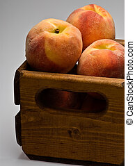 Fresh Peaches in crate