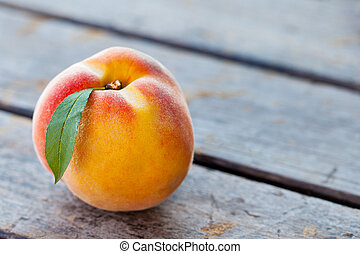 Fresh peaches on grey wooden background. Close up. Copy space.