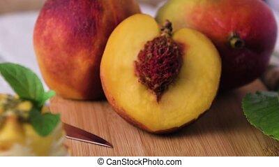 Fresh peaches on wood - fresh peaches on wood background.