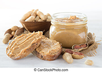 Fresh peanut butter on white background