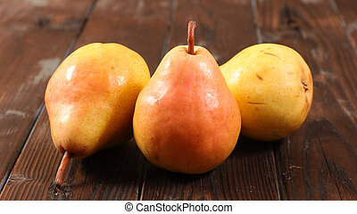 fresh pear on wood