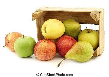 Fresh pears and apples in a wooden crate