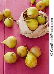 Fresh pears - Fresh ripe pears in paper bag on wooden ...