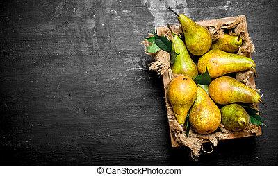 Fresh pears in the box.