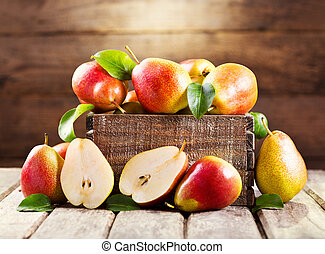 fresh pears in wooden box