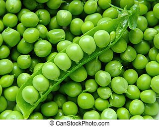Fresh young peas background macro