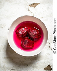 Fresh peeled beets in a bowl.