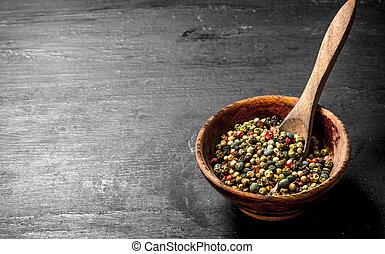 Fresh pepper in grains in a bowl.