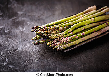 Fresh picked asparagus in horizontal format on black...