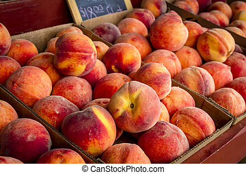 Fresh picked peaches from orchard - Orchard market display...